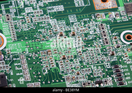 Macro view of a motherboard showing all the detalis of the circuitry. - Stock Photo