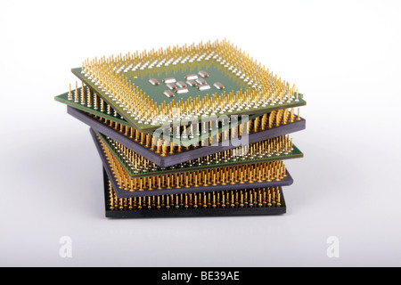 Stack of several central processing units of various types and shapes. - Stock Photo