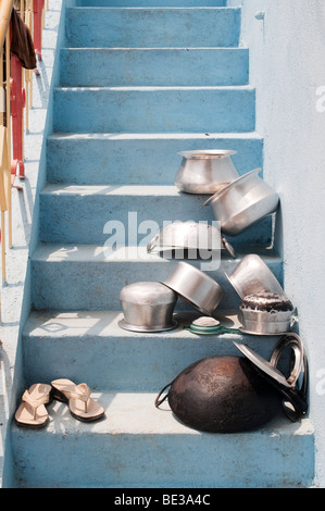Indian cooking pots left in the sun to dry on the staircase of an indian home. Andhra Pradesh, India - Stock Photo