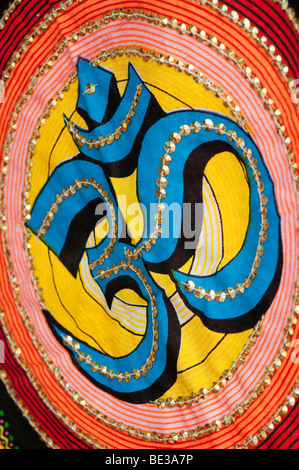OM / AUM  / Indian hindu symbol on a fabric wall hanging - Stock Photo