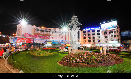 Small park with sculpture at the main square in front of the market, Cho Da Lat, at night, Dalat capital, Central - Stock Photo
