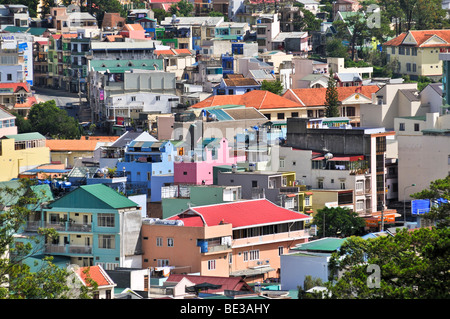 View over the colorful houses and rooftops of the Dalat capital, Central Highlands, Vietnam, Asia - Stock Photo