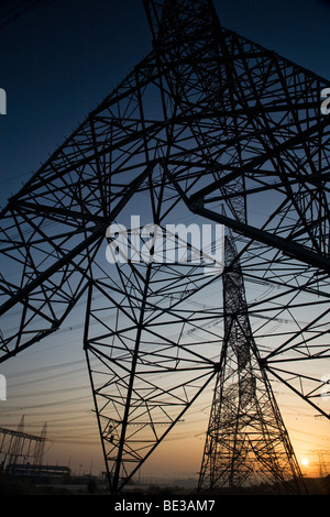 Transmission lines towers tower pylon power line - Stock Photo
