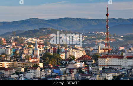 View over the rooftops of Dalat with the 'Dalat Eiffel Tower', Central Highlands, Vietnam, Asia - Stock Photo