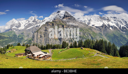 Panoramic view from Mt. Allmendhubel to the mountain inn and on the Eiger, Moench and Jungfrau mountains in the - Stock Photo