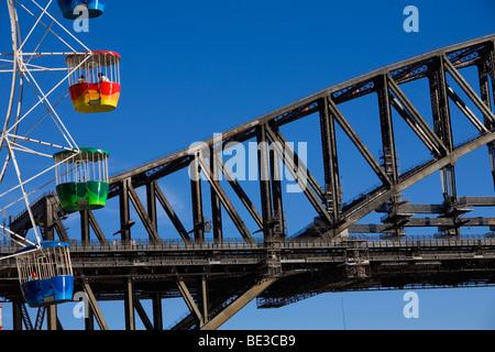 Luna Park ferris wheel and the Harbour Bridge on Sydney's North Shore. Sydney, New South Wales, AUSTRALIA - Stock Photo