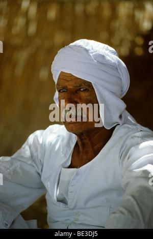 Bedouin in traditional dress, Egyptian, garment, portrait, Dschjellahba, Jelleba, beard, pride, linen, Arabian, - Stock Photo
