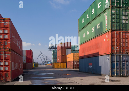 Bonn harbour, overlooking the terminal, cranes in the back, stacked oversea containers in the front, North Rhine - Stock Photo
