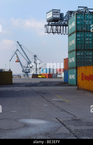 Bonn Harbour, overlooking the terminal, cranes and gantry crane in the back, stacked oversea containers in the front, - Stock Photo