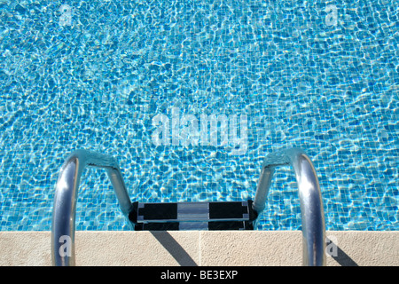 Hotel swimming pool with sunny reflections, great for summer and vacations themes and backgrounds - Stock Photo