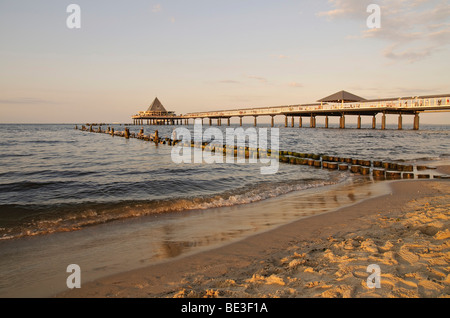 Pier in the Heringsdorf seaside resort, at sunset, Usedom Island, Mecklenburg-Western Pomerania, Germany, Europe - Stock Photo