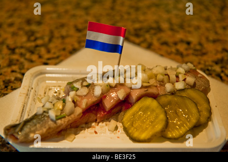 traditional dutch snack with raw herring with pickles stock photo 166530083 alamy. Black Bedroom Furniture Sets. Home Design Ideas