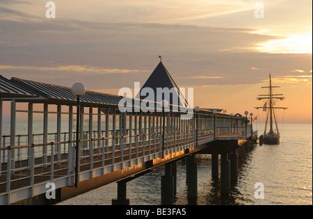 Pier in the Heringsdorf seaside resort, at sunrise, Usedom Island, Mecklenburg-Western Pomerania, Germany, Europe - Stock Photo