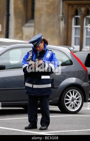 Traffic Warden Writing a Ticket, Oxford, England, United Kingdom. - Stock Photo