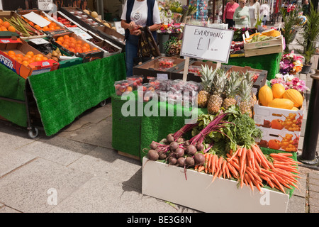Green grocers shop selling unwrapped fruit and vegetable on display outside. England, UK. - Stock Photo