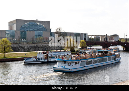Excursion boats on the Spree River in front of the Moltkebruecke Bridge at the Federal Chancellery, Berlin, Germany, - Stock Photo