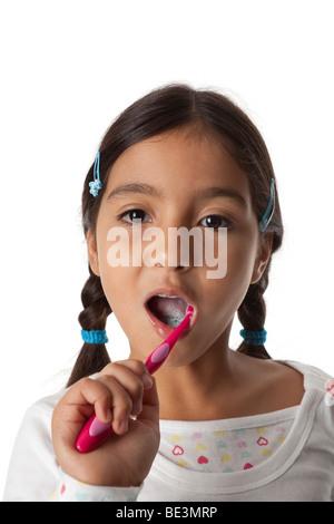 Little girl is brushing her teeth - Stock Photo