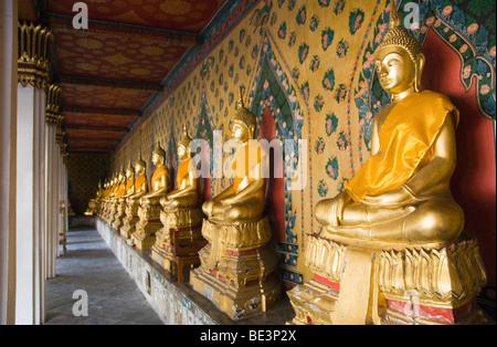 Golden Buddha statue in the Wat Arun Temple, Bangkok, Thailand, Asia - Stock Photo