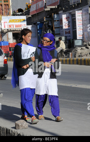 Students in uniform on the way home in Leh, Ladakh, Northern India, India, Himalayas - Stock Photo