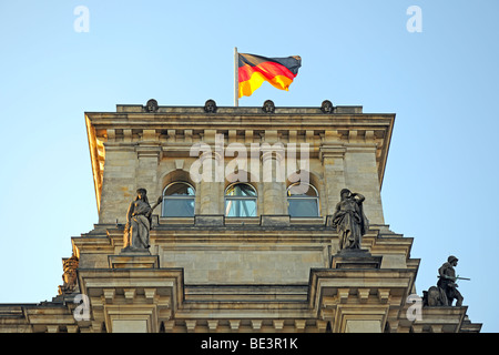 Flag of Germany on one of the towers of the Reichstag building in Berlin, Germany, Europe - Stock Photo