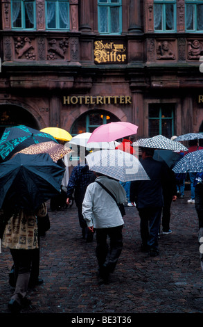 Umbrellas in front of the Hotel Ritter Heidelberg Germany June 2005 - Stock Photo