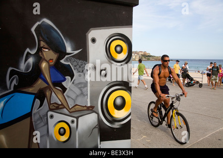 Graffiti artwork and locals on the promenade at Bondi Beach. Sydney, New South Wales, AUSTRALIA - Stock Photo