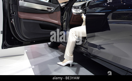 63th International Motor Show ( IAA ): Woman sitting in a car of the car manufacturer BMW - Stock Photo