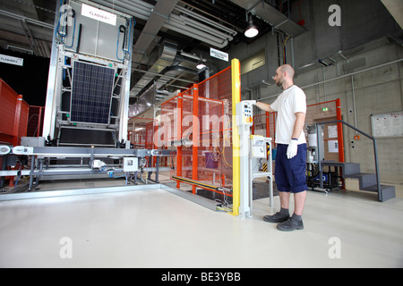 Solon SE: production of solar panels. Worker during the final quality control, BERLIN, GERMANY