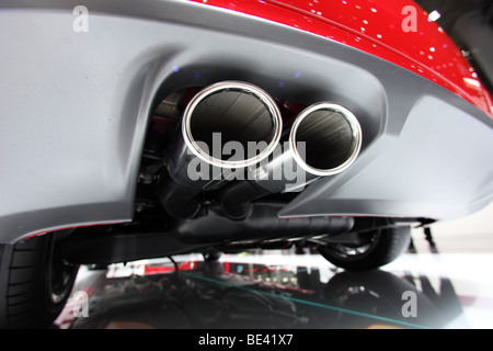Exhaust pipes of a passenger car. - Stock Photo
