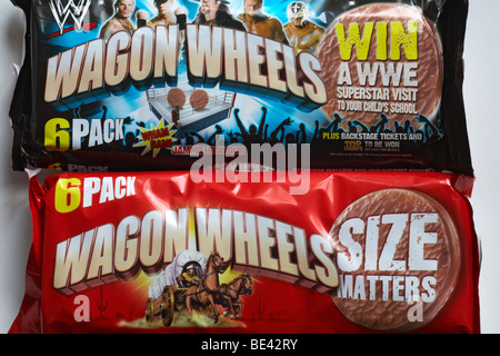Wagon Wheels biscuits biscuit - 6 pack packets of original plain and jammie flavour Wagon Wheels biscuits - Stock Photo