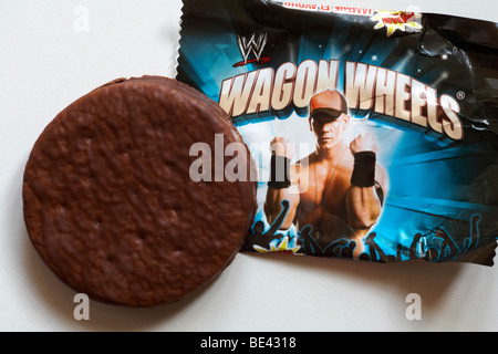 Wagon Wheels biscuit - individual packet of jammie flavour Wagon Wheels biscuits set on white background - Stock Photo