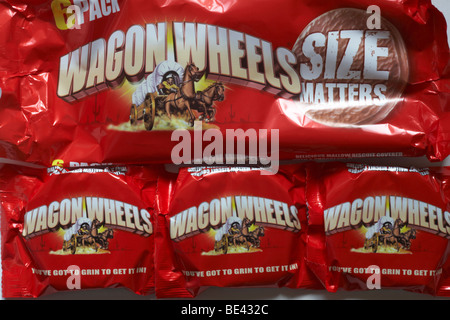 packets of Wagon Wheels biscuits - you've got to grin to get it in - delicious mallow biscuit covered with a chocolate - Stock Photo