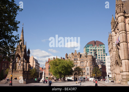 The town Hall Victorian neo-Gothic building and Albert monument in Albert Square, Manchester, England, UK, Britain. - Stock Photo