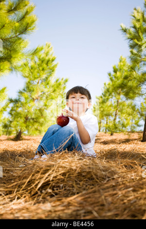 boy holding red apple - Stock Photo