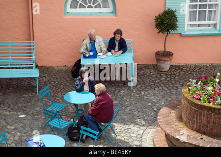 Elderly people taking tea in Battery Square, Portmeirion Wales UK - Stock Photo