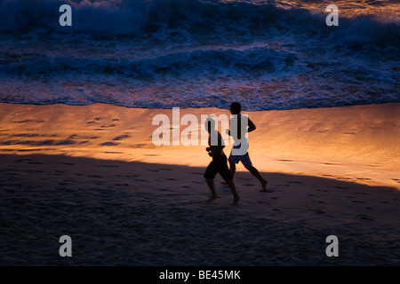 Joggers on Bondi Beach at dawn. Sydney, New South Wales, AUSTRALIA - Stock Photo
