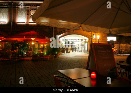 S-Bahnhof Hackescher Markt station with restaurants with outdoor seating at night, Mitte, Berlin, Germany, Europe - Stock Photo