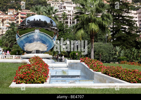 gardens in front of the casino which is reflected in the mirror place du casino monte carlo monaco south of france - Stock Photo