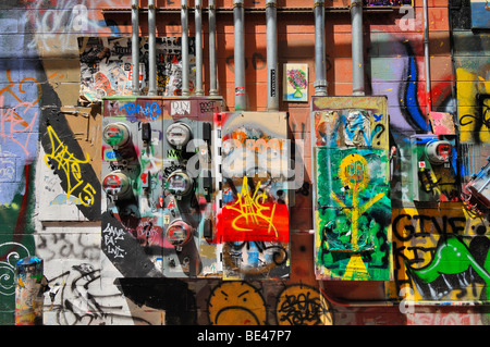Art Alley is an ugly street in an attractive town. To overcome this problem the city authorities encouraged graffiti - Stock Photo