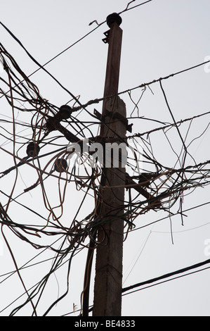 Electricity pylon and cables in an Indian street. Andhra Pradesh, India - Stock Photo
