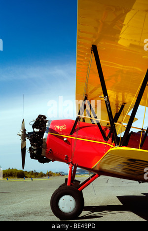 The old Waco bi-plane at the airport ready to fly and kiss the blue sky good morning. - Stock Photo