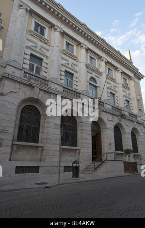 Rieti, Italy. Main face of the Palazzo delle Poste e dei Telegrafi by Cesare Bazzani (1934) in via Garibaldi. - Stock Photo