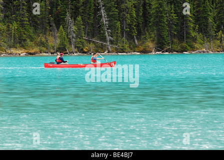 Canoeing on Lake Louise in Banff National Park, Alberta, Canada - Stock Photo