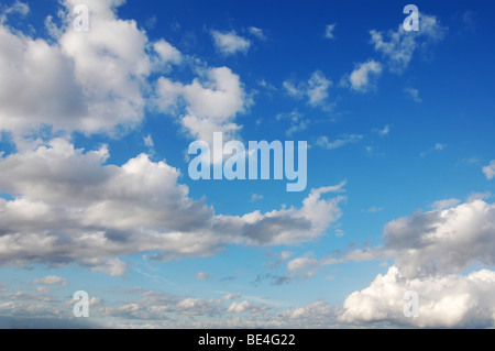 Blue sky with fluffy clouds in sunshine day - Stock Photo