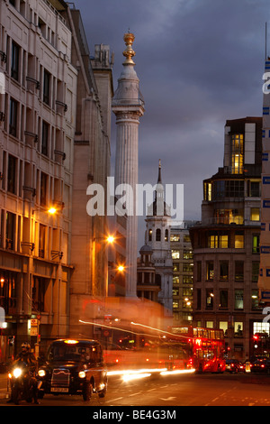 Traffic in the city, with a typical red-Bus, Monument, City of London, England, United Kingdom, Europe - Stock Photo