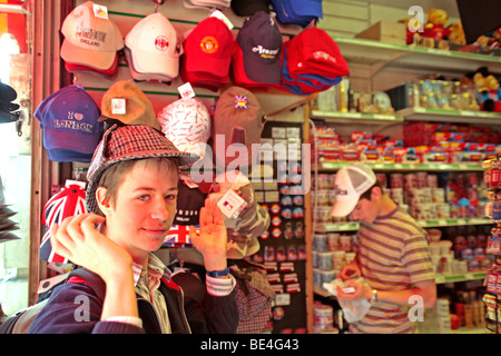two teenage boys looking at souvenirs in a souvenir shop  London    Stock Photo. two teenage boys in a souvenir shop in London Stock Photo  Royalty