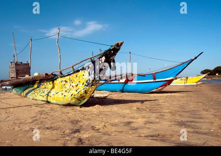 Colorful Colourful Fishing boats on the beach Arugam Bay Sri Lanka - Stock Photo