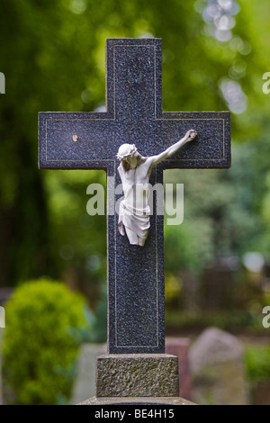Stone cross with broken Christ figure on a grave, castle cemetery Bad Godesberg, Bonn, North Rhine-Westphalia, Germany, - Stock Photo