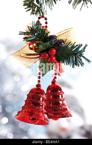 Red bells hanging from fir branches, Christmas decoration - Stock Photo
