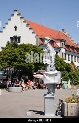 Lindau, Bavaria, Germany. Living statue mime artist on waterfront promenade in picturesque Old Town (Altstadt) on - Stock Photo